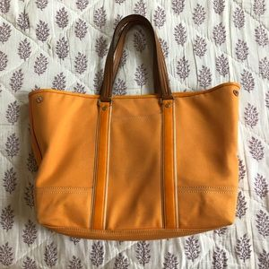 Coach tangerine canvas tote with leather handles